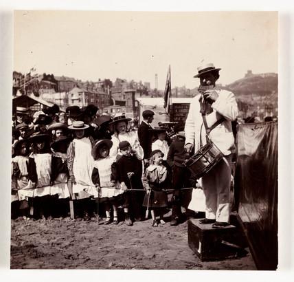 Beach entertainer, c 1905.