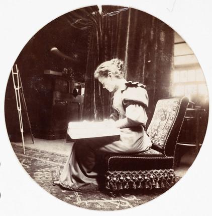 Woman reading, c 1890