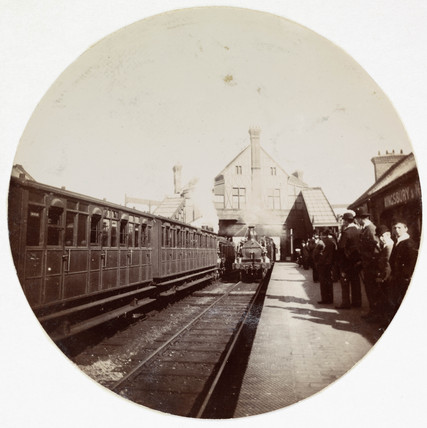 Train at a railway station, London, c 1890.