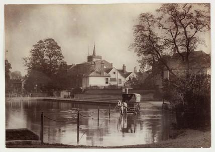 Wagon crossing a ford, c 1890.