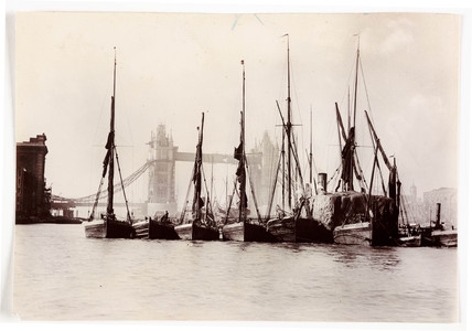 Boats moored at Tower Bridge, 1890s.
