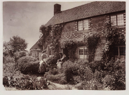 Mothers outside a cottage, c 1890.