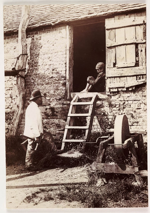 By the grindstone, c 1890.