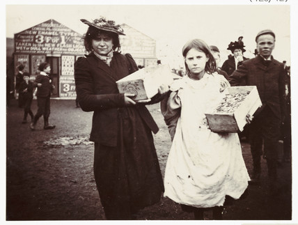 Woman and girl selling souvenirs, c 1900.