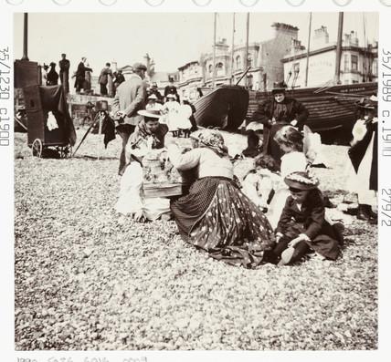 Souvenir seller on the beach, c 1905.