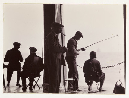 Men fishing, c 1930.