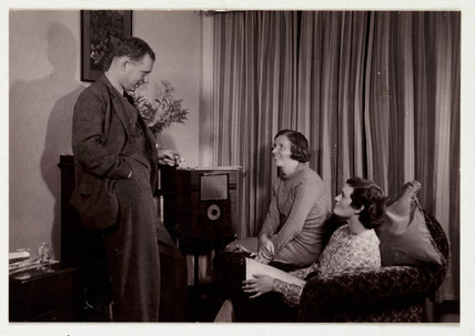 Listening to the radio, c 1935.