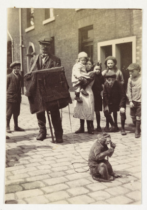 Organ grinder and his monkey, c 1920.