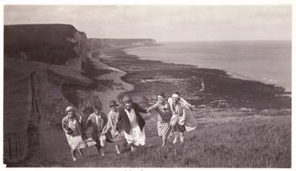 Women climbing a hill, c 1920.