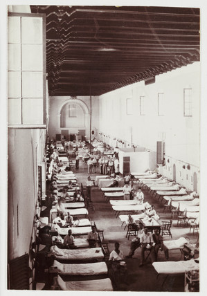 Beds lined up in a military hospital, C 1916.