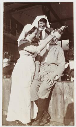 Nurse shaving a soldier, c 1918.