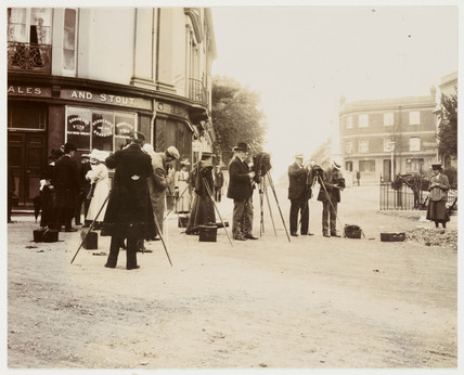 Group of photographers taking photographs in the street, 19th century.