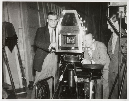 Crew operating a film camera on set, c 1940s.