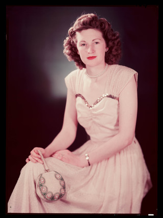 'Miss B Hall (Testing Department)' wearing an evening dress, c 1943.
