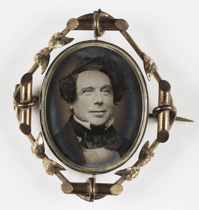 Small portrait of a man contained in a brooch, mid-late 19th century.