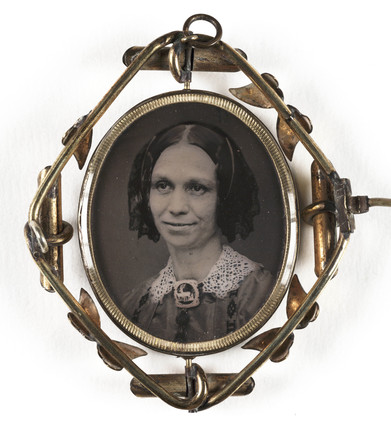 Small portrait of a woman contained in a brooch, mid-late 19th century.