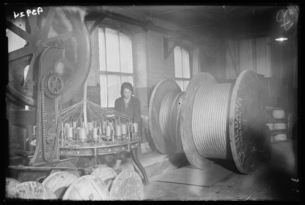 Worker operating a braiding machine, 1933