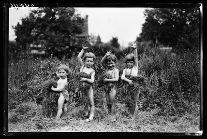 Four children in a field, 1932.