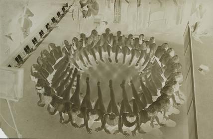 Circle of dancers, 1930s.