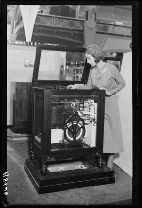 Woman looking into a radiogram at Radiolympia, Olympia, London, 1932.