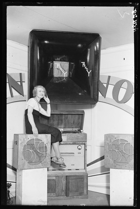 Woman listening to a Tannoy, Radiolympia, London, 1932.