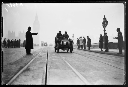 Vintage car crossing Westminster Bridge, c 1935.