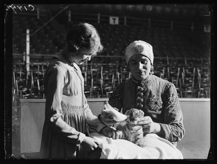 Feeding a tiger cub, 1933.
