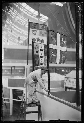 Man painting in preparation for the British Industries Fair, 1933.
