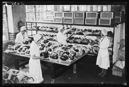 Making chocolate Easter Eggs, 1933.