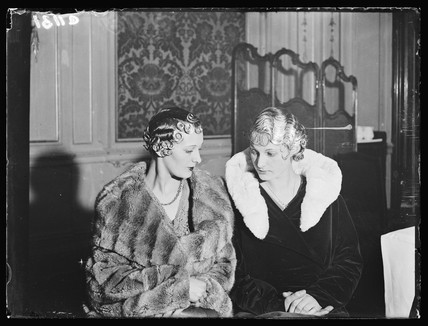 Two models displaying the latest hairdressing fashions, 15 March 1933.