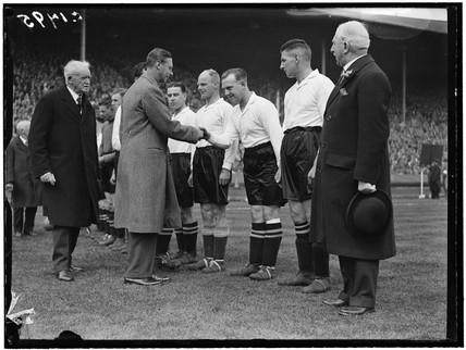 The Duke of York meeting the Everton football team, April 1933.