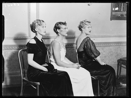 Three models displaying the latest in women's hairdressing fashions, 1933.