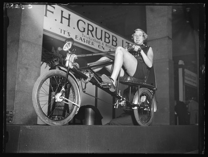 Woman on a horizontal bicycle, 1933.