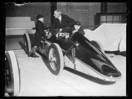 Two schoolboys admiring a racing car, Schoolboy's Own exhibition, 1933