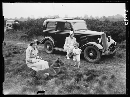Family with their car in the country, 1934.