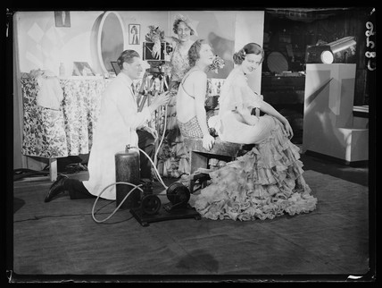 Applying film makeup, 1934.