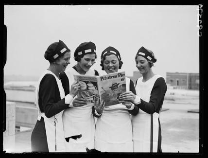 Four women reading 'Printers' Pie' magazine, 1934.