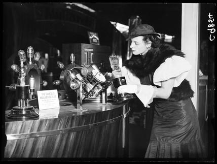 Woman examining Mullard valves, Radiolympia, Olympia, London, 1934.