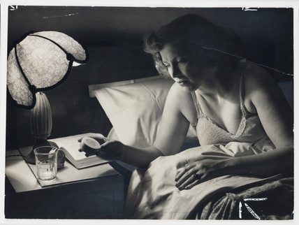 Woman taking sleeping pills, 1954.