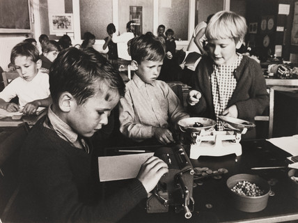 Children using an adding machine and balance, 1967.