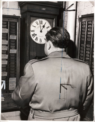 A worker clocking on, 1959.