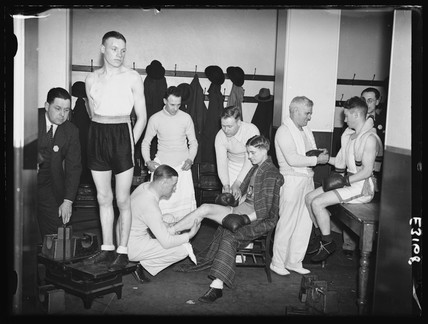 Amateur boxers prepare in the changing room, Royal Albert Hall, London, 1935.