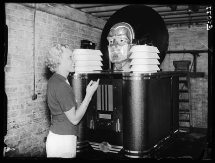 Woman listening to the 'Telepathovox', Radiolympia, Olympia, London, 1935.