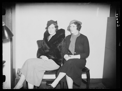 Women modelling hats, 1936.