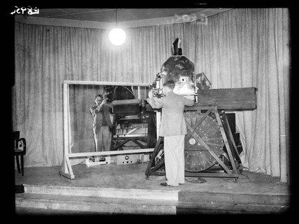 Demonstrating the Scophony television, 1936.