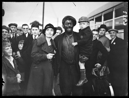Miner with his family, South Wales, 6 September 1936.