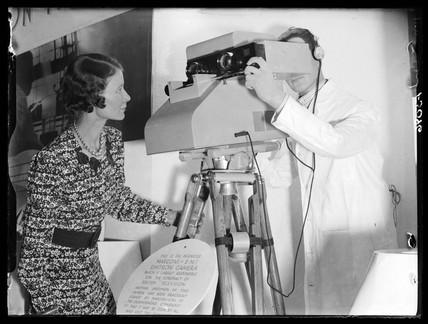 Demonstrating an Emitron television camera, Radiolympia, London, 1937.