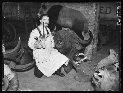 Man with hunting 'trophies', 1938
