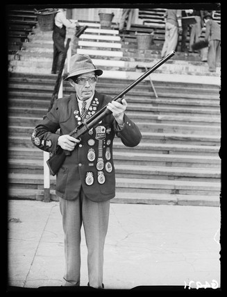 Clay pigeon shooting champion, White City, London, 1938.