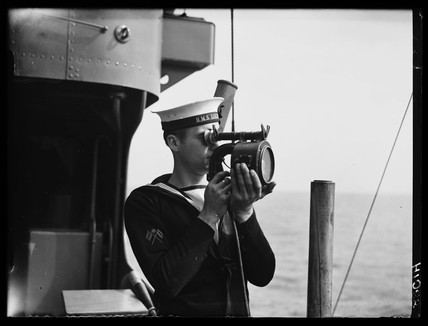 Sailor with signalling lamp, 1939.